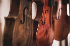 Hand made violins. Woodworking art, an honest occupation within a sustainable lifestyle. Carpentry and cutting. royalty free stock image
