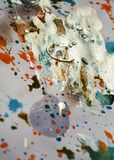 Watercolor paint orange gray silver brush strokes, vivid hues, spots. Hand made waxy burnt design with  blue, gold, white, silvery, violet, vivid hues and colors Royalty Free Stock Image
