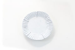 Hand made white porcelain plate with fluted rim Stock Image