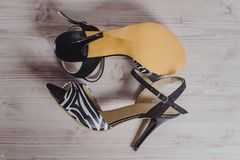 Hand-made women`s dance shoes made of genuine leather on the wooden surface royalty free stock photo