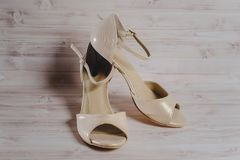Hand-made women`s dance shoes made of genuine leather on the wooden surface royalty free stock photography