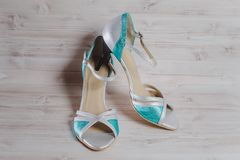 Hand-made womens dance shoes made of genuine leather on the wooden surface. Macro photography Stock Photography