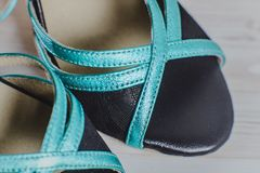 Hand-made womens dance shoes made of genuine leather on the wooden surface. Macro photography. black and turquoise style. closeup Royalty Free Stock Photos