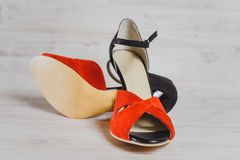 Hand-made womens dance shoes made of genuine leather on the wooden surface. Macro photography. pearl and gray color colored style close Stock Photo