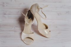 Hand-made womens dance shoes made of genuine leather on the wooden surface. Macro photography. pearl and gray color colored style close Royalty Free Stock Photography