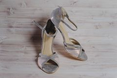 Hand-made womens dance shoes made of genuine leather on the wooden surface. Macro photography. pearl and gray color colored style close Stock Photos