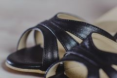 Hand-made womens dance shoes made of genuine leather on the wooden surface. Macro photography. black color style. closeup Royalty Free Stock Photography