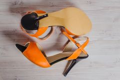 Hand-made womens dance shoes made of genuine leather on the wooden surface. Macro photography. orange color colored style close Stock Images