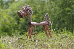 Wooden horse on grass. Hand made wooden horse on green grass Royalty Free Stock Photos