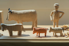 Hand-made wooden toys: man and animals Royalty Free Stock Image