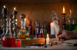Hand, magic potion, ancient books Royalty Free Stock Images