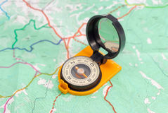 Hand magnetic compass on a tourist topographical map Royalty Free Stock Photos