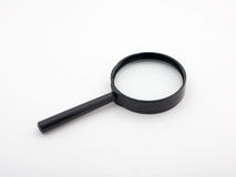 Hand magnifier. Magnifying glass on white background Royalty Free Stock Photography