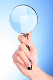 hand with magnifier Royalty Free Stock Images
