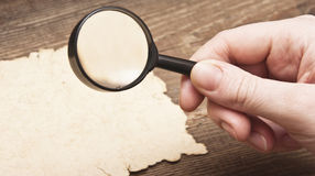 Hand with a magnifier Royalty Free Stock Image