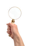 Hand with a magnifier Stock Photo