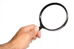 HAND WITH MAGNIFYING GLASS Royalty Free Stock Photo