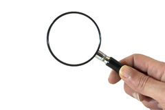 Hand with magnifying glass Stock Photos