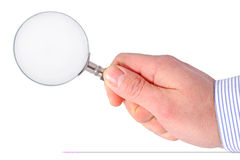 Hand with magnifying glass Royalty Free Stock Photos