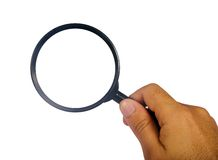 Hand with magnifying glass Royalty Free Stock Photography