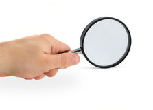 Hand with magnifying glass stock photography