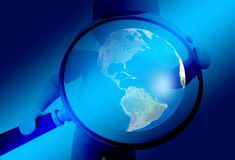 Hand, Magnifying Glass, Earth Royalty Free Stock Images