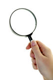 Hand with a magnifying glass Stock Photography