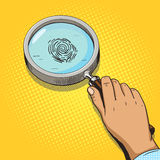 Hand with magnifying glass pop art vector Royalty Free Stock Image