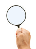 Hand and magnifying glass on white background Royalty Free Stock Images