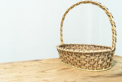 Hand make basket on wooden table on white background Royalty Free Stock Photo