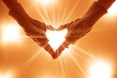 Hand make a heart Stock Photos