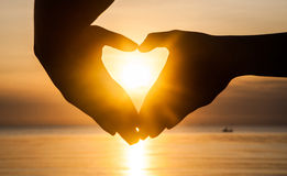 Hand make heart with sunset Royalty Free Stock Image
