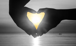 Hand make heart with sunset Royalty Free Stock Images