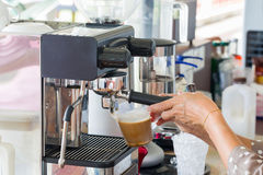 Hand make a latte cup of coffee machine. Stock Image