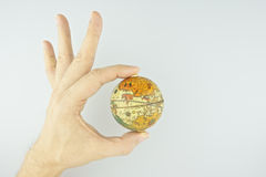 Hand make signal by ok with upside down globe isolated Royalty Free Stock Images
