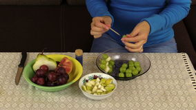 Hand make snack grape and pears on wooden stick fruit vase table stock footage