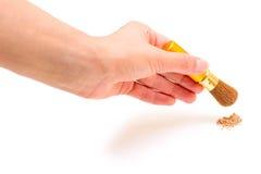 Hand with make-up brush Stock Photo