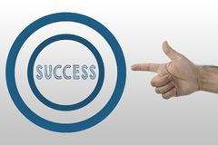 Doomed to Succeed. Hand makeing pistol gesture and Success text. Doomed to Succeed Stock Photos