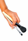 Hand with makeup brushes Royalty Free Stock Images