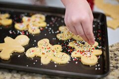 Hand making Christmas cookies Royalty Free Stock Image