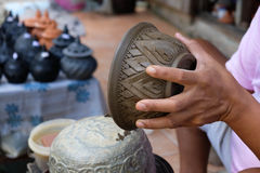 Hand making pottery and carving cup. That last step Royalty Free Stock Photo
