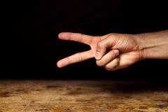 Hand making scissor gesture Stock Photo