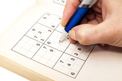 Hand making a sudoku Stock Photo
