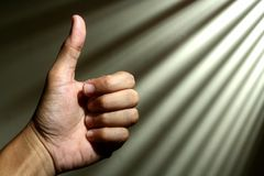 Hand making a thumbs up sign Stock Photography