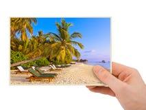 Hand and Maldives beach image (my photo) Royalty Free Stock Image