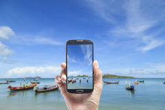 Hand male Asian holding smartphone taking picture of beautiful b Stock Images