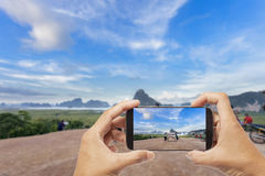 Hand male asian holding Smartphone taking picture of beautiful l Royalty Free Stock Photo
