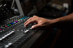Hand of male audio engineer using sound mixer Stock Photography