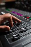 Hand of male audio engineer using sound mixer Royalty Free Stock Photo