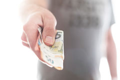 Hand of male person handing over different euro bills stock photos